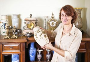 Lady with antiques Bassetts' Estate Sales